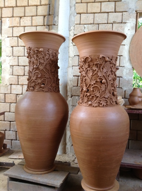 Two commissioned huge ceramic vases ready to be delivered somewhere special.