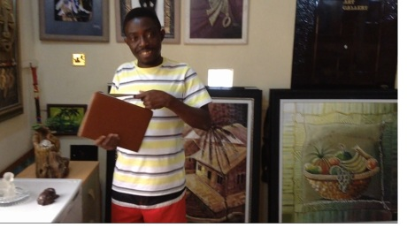 Gbolade Omidiran in his gallery showing me  his online gallery