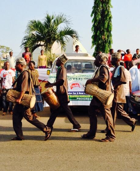 Singing and drumming. The traditional Yoruba drums-Gangan and Bata.