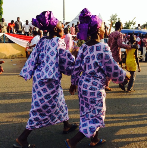 Two sisters dressed in the colourful Yoruba Gele and matching outfits